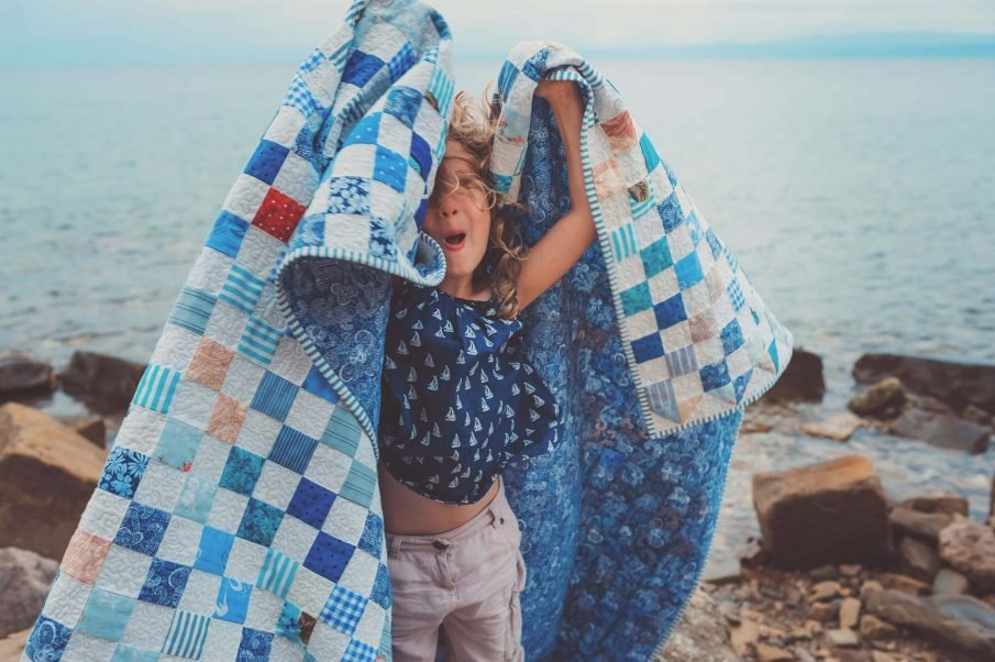 child with quilt, memory quilt ideas