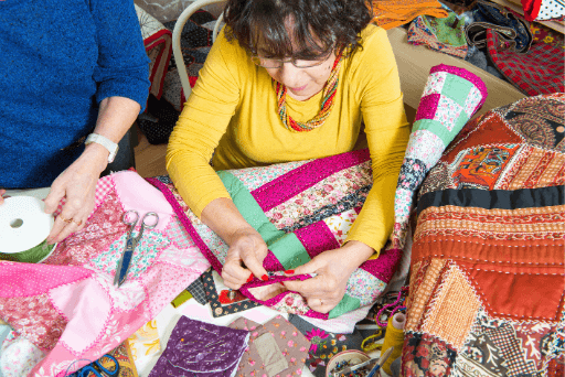 women quilting quilting bee
