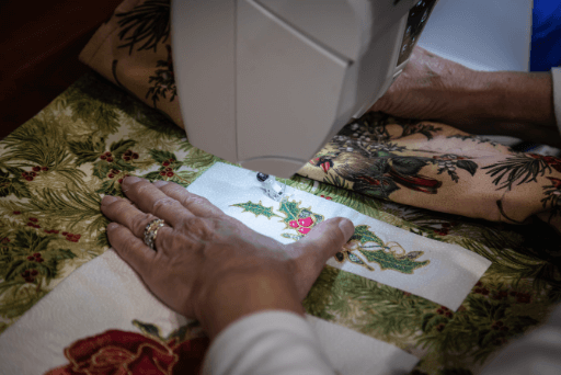 woman using sewing machine quotes about quilting